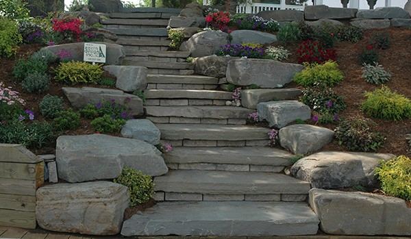 Decorative boulders next to rustic stone steps