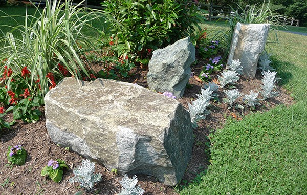 Decorative boulders in a flower garden